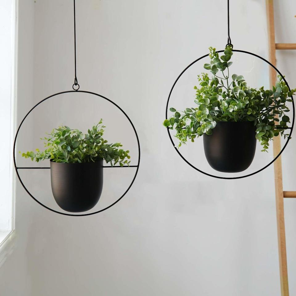 """You'll get so many compliments on these you'll love having them a<i>round</i>your place.<br /><br /><strong>Promising review:</strong>""""These are the perfect addition to your mid-century modern, boho, farmhouse, or whatever style you're rocking indoor jungle!<strong>I love the versatility of hanging them alone or connecting two or more together!</strong>They fit a standard 6"""" grower pot inside which allows you to remove the plant for easy watering. I highly recommend these!!!!"""" —<a href=""""https://www.amazon.com/gp/customer-reviews/R28CKUGSVBZEN?&linkCode=ll2&tag=huffpost-bfsyndication-20&linkId=6047ebe4537d97368e242841f8e3c280&language=en_US&ref_=as_li_ss_tl"""" target=""""_blank"""" rel=""""nofollow noopener noreferrer"""" data-skimlinks-tracking=""""5854435"""" data-vars-affiliate=""""Amazon"""" data-vars-href=""""https://www.amazon.com/gp/customer-reviews/R28CKUGSVBZEN?tag=bfmal-20&ascsubtag=5854435%2C12%2C37%2Cmobile_web%2C0%2C0%2C16324230"""" data-vars-keywords=""""cleaning,fast fashion"""" data-vars-link-id=""""16324230"""" data-vars-price="""""""" data-vars-product-id=""""20942027"""" data-vars-product-img="""""""" data-vars-product-title="""""""" data-vars-retailers=""""Amazon"""">Amazon Customer<br /><br /></a><strong>Get them from Amazon for<a href=""""https://www.amazon.com/Abetree-Hanging-Planters-Ceiling-Minimalist/dp/B07Z34TJ2R?&linkCode=ll1&tag=huffpost-bfsyndication-20&linkId=8f89ee78768b6bd2622e3099be82f5ea&language=en_US&ref_=as_li_ss_tl"""" target=""""_blank"""" rel=""""nofollow noopener noreferrer"""" data-skimlinks-tracking=""""5854435"""" data-vars-affiliate=""""Amazon"""" data-vars-asin=""""B07Z34TJ2R"""" data-vars-href=""""https://www.amazon.com/dp/B07Z34TJ2R?tag=bfmal-20&ascsubtag=5854435%2C12%2C37%2Cmobile_web%2C0%2C0%2C16323378"""" data-vars-keywords=""""cleaning,fast fashion"""" data-vars-link-id=""""16323378"""" data-vars-price="""""""" data-vars-product-id=""""18221612"""" data-vars-product-img=""""https://m.media-amazon.com/images/I/51DkuiwnY4L._SL500_.jpg"""" data-vars-product-title=""""Abetree 2 Pcs Hanging Planters for Indoor and Outdoor Plants with Hooks and Chains Metal Modern Wa"""