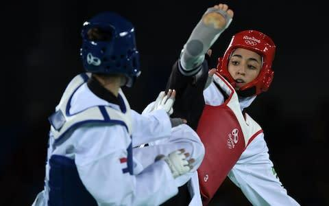 <span>Iran's Kimia Alizadeh competing in the 2016 Rio Olympics</span> <span>Credit: ED JONES/AFP via Getty Images </span>