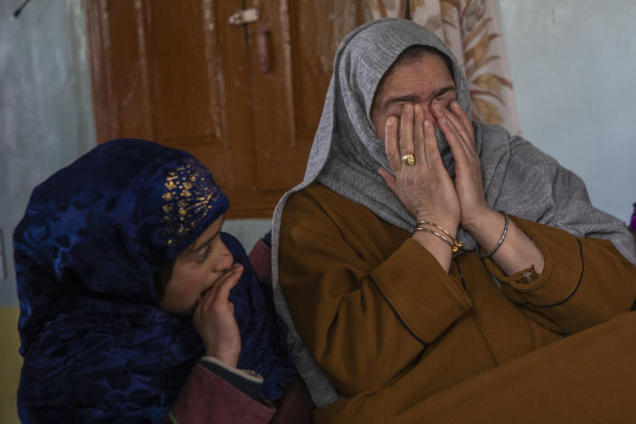 "Dilshada Banoo, aunt of 16-year-old Athar Mushtaq, breaks down while talking to Associated Press in Bellow, south of Srinagar, Indian controlled Kashmir, Tuesday, Jan. 5, 2021. On the last week of 2020, Indian government forces killed Athar and two other young men during a controversial gunfight on the outskirts of the Indian-controlled Kashmir's main city. Police did not call them anti-India militants but ""hardcore associates of terrorists."" They later buried them at a graveyard in a remote mountainous tourist resort miles away from their ancestral villages. Athar was the latest Kashmiri to be buried in a far-off graveyard after Indian authorities in a new controversial policy in 2020 started to consign blood-soaked bodies of scores of Kashmiri suspected rebels to unmarked graves, denying the mourning families a proper funeral and a burial. (AP Photo/ Dar Yasin)"