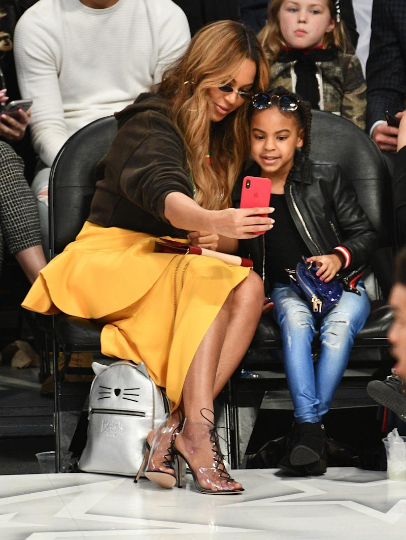 Beyonce wore Gianvito Rossi boots with a Jacquemus skirt while attending The 67th NBA All-Star Game: Team LeBron Vs. Team Stephen at Staples Center on February 18, 2018 in Los Angeles, California with her daughter Blue Ivy and mother Tina Knowles.