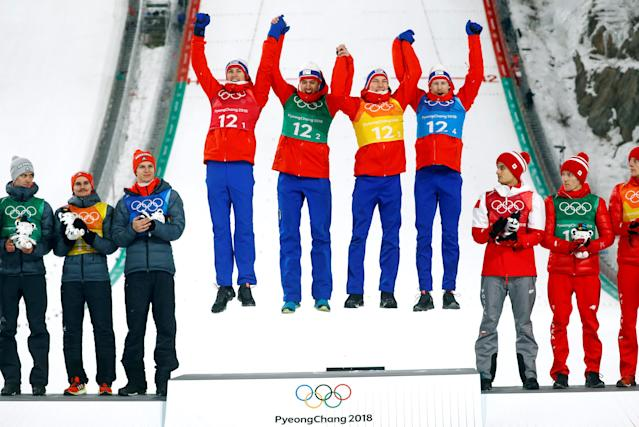 Ski Jumping - Pyeongchang 2018 Winter Olympics - Men's Team Final - Alpensia Ski Jumping Centre - Pyeongchang, South Korea - February 19, 2018 - Gold medalists Daniel Andre Tande, Andreas Stjernen, Johann Andre Forfang and Robert Johansson of Norway celebrate during the victory ceremony. REUTERS/Kai Pfaffenbach TPX IMAGES OF THE DAY