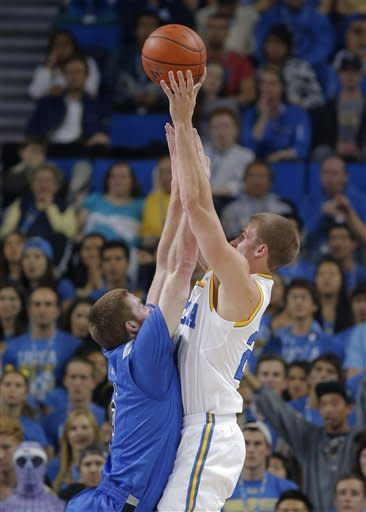 UCLA's Travis Wear, right, shoots as he is defended by Indiana State's Justin Gant during the first half of an NCAA college basketball game in Los Angeles, Friday, Nov. 9, 2012. (AP Photo/Jae C. Hong)