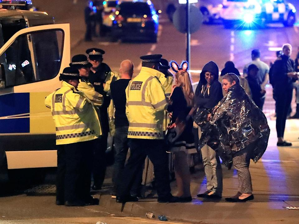 <p>Emergency services personnel speak to people outside Manchester Arena after reports of an explosion at the venue during an Ariana Grande concert in Manchester, England, Monday, May 22, 2017. Several people have died following an explosion Monday night at an Ariana Grande concert in northern England, police and witnesses said. The singer was not injured, according to a representative. (Peter Byrne/PA via AP) </p>