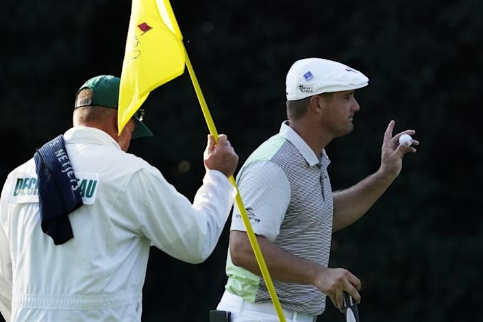 Bryson DeChambeau holds up his ball after a birdie on the sixth hole during the second round.