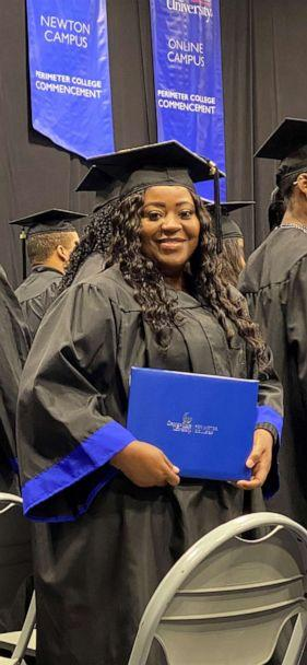 PHOTO: Latonya Young poses at her December 2019 graduation ceremony at Georgia State University. (Courtesy Kevin Esch)