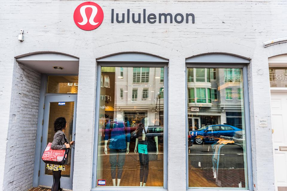 Washington DC: Lululemon building exterior with woman entering store by sign.