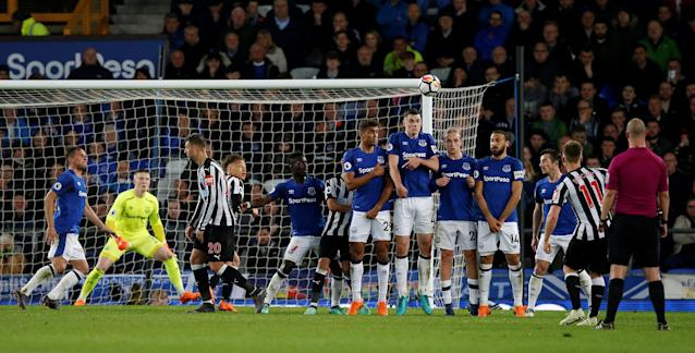 "Soccer Football - Premier League - Everton v Newcastle United - Goodison Park, Liverpool, Britain - April 23, 2018 Newcastle United's Matt Ritchie shoots at goal from a free kick REUTERS/Andrew Yates EDITORIAL USE ONLY. No use with unauthorized audio, video, data, fixture lists, club/league logos or ""live"" services. Online in-match use limited to 75 images, no video emulation. No use in betting, games or single club/league/player publications. Please contact your account representative for further details."