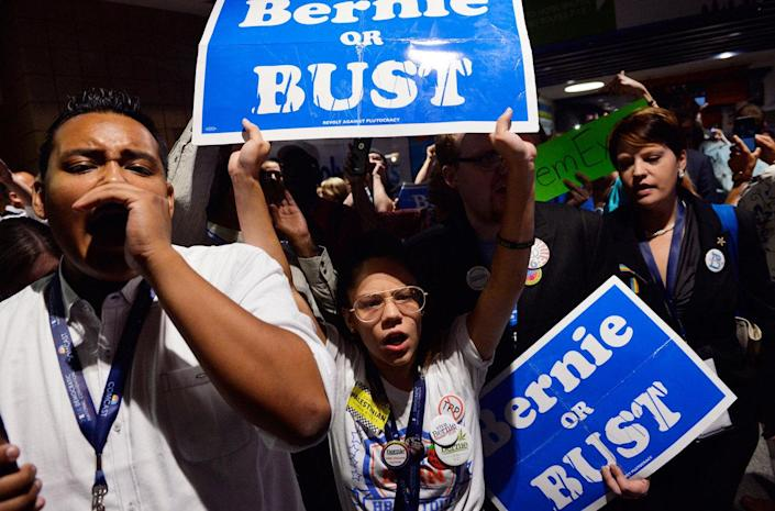 <p>Supporters of former Democratic Presidential candidate Senator Bernie Sanders walk out in protest after he moved to suspend the rules and nominate Hillary Clinton during the Democratic National Convention in Philadelphia, Pa., July 26, 2016. (Photo: Charles Mostoller/Reuters)</p>
