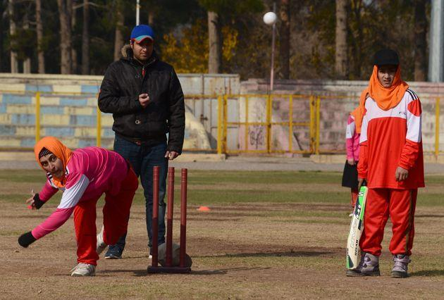 Afghan women play cricket at the grounds of the stadium in Herat on December 9, 2015. Womens sports participation in Afghanistan has increased since the 2001 fall of the hardline Islamist Taliban.  AFP PHOTO / Aref Karimi / AFP / Aref Karimi        (Photo credit should read AREF KARIMI/AFP via Getty Images) (Photo: AREF KARIMI via Getty Images)