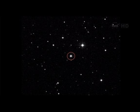 """A star field image shows Voyager 1 spacecraft's next destination in the universe (circled). According to NASA, """"In about 40,000 years, Voyager 1 will drift within 1.6 light-years (9.3 trillion miles) of AC+79 3888, a star in the constellation o"""