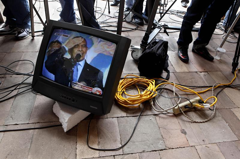 FILE - In this Jan 29, 2010 file photo, Honduras' President Porfirio Lobo appears on a screen from a TV crew during a press conference at a presidential house in Tegucigalpa, Honduras. Three years after former President Manuel Zelaya was run out of office at gunpoint and in his pajamas, current president Porfirio Lobo twice publicly warned that his elite adversaries were conspiring to oust him in a coup, then provoked a constitutional crisis with the judges' removal, an act that legal scholars describe as everything from an abuse of power to a betrayal of the country. (AP Photo/Esteban Felix, file)