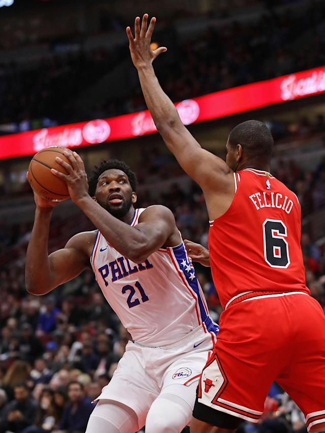 Joel Embiid #21 of the Philadelphia 76ers moves to shoot against Cristiano Felicio #6 of the Chicago Bulls at the United Center on April 06, 2019 in Chicago, Illinois. (Photo by Jonathan Daniel/Getty Images)