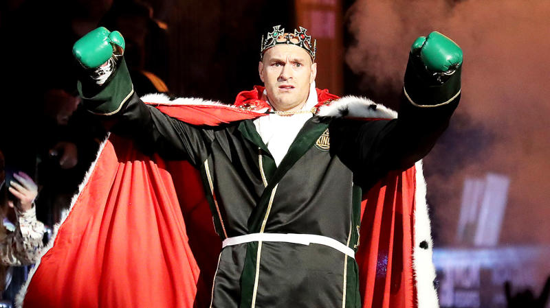 Tyson Fury dressed as a king and raising his hands as he enters the ring ahead of his fight with Deontay Wilder. (Getty Images)