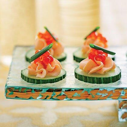 """<p>Spread the love for your favorite seafood at your next party with crowd-pleasing Smoked Salmon Mousse Canapés. </p><p><a href=""""https://www.myrecipes.com/recipe/smoked-salmon-mousse-canapes"""" rel=""""nofollow noopener"""" target=""""_blank"""" data-ylk=""""slk:Smoked Salmon Mousse Canap&#233;s Recipe"""" class=""""link rapid-noclick-resp"""">Smoked Salmon Mousse Canap&#233;s Recipe</a></p>"""
