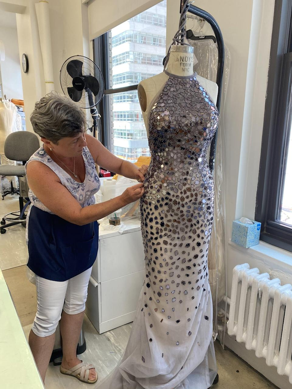 <p>The Lavender gown, as its named, comes complete with mirrored stones that trickle down the bodice and skirt of the halter-style dress.</p>