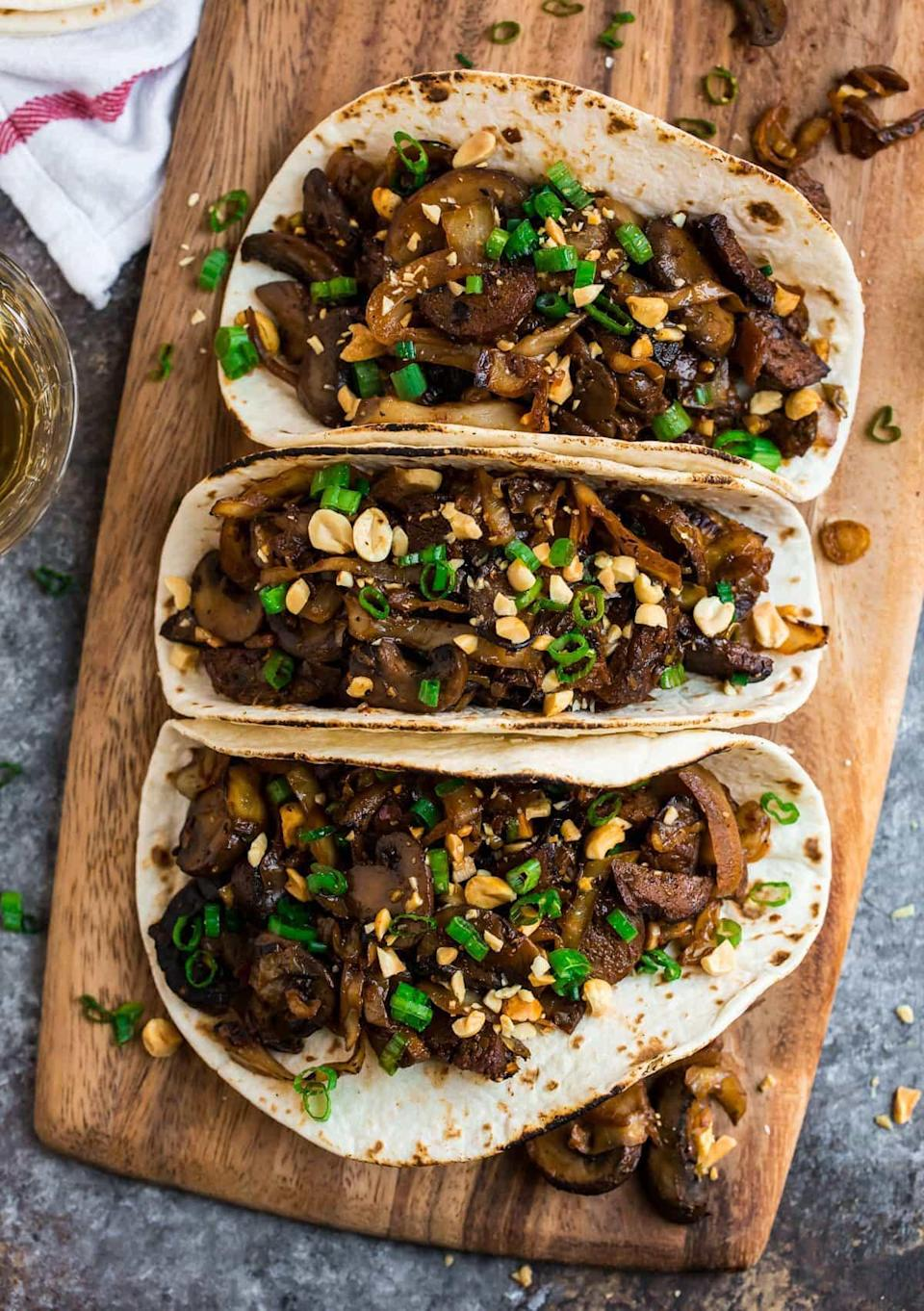 """<p>You can use almost any kind of mushroom to whip up these vegan tacos with a savory, soy-based sauce.</p> <p>Get the recipe <a href=""""https://www.wellplated.com/mushroom-tacos/"""" rel=""""nofollow noopener"""" target=""""_blank"""" data-ylk=""""slk:here"""" class=""""link rapid-noclick-resp"""">here</a>.</p>"""