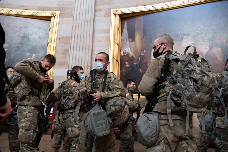 Members of the National Guard walk through the Rotunda of the US Capitol in Washington, DC, January 13, 2021, ahead of an expected House vote impeaching US President Donald Trump. - The Democrat-controlled US House of Representatives on Wednesday opened debate on a historic second impeachment of President Donald Trump over his supporters' attack of the Capitol that left five dead.Lawmakers in the lower chamber are expected to vote for impeachment around 3:00 pm (2000 GMT) -- marking the formal opening of proceedings against Trump. (Photo by SAUL LOEB / AFP) (Photo by SAUL LOEB/AFP via Getty Images)