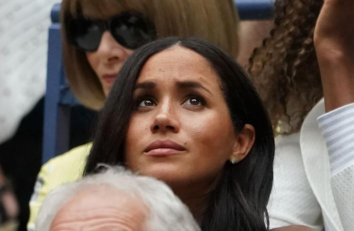 Meghan, Duchess of Sussex watches Serena Williams play Bianca Andreescu of Canada during the Women's Singles Finals match at the 2019 U.S. Open at the USTA Billie Jean King National Tennis Center in New York on Sept. 7, 2019. | TIMOTHY A. CLARY—AFP/Getty Images