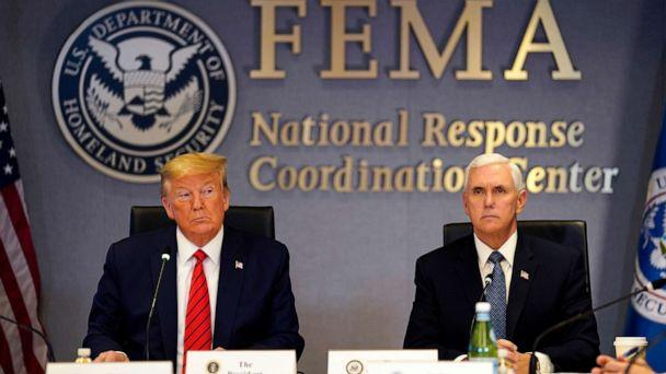PHOTO: President Donald Trump and Vice President Mike Pence attend a teleconference with governors at the Federal Emergency Management Agency (FEMA) headquarters, on March 19, 2020, in Washington. (Evan Vucci-Pool/Getty Images)