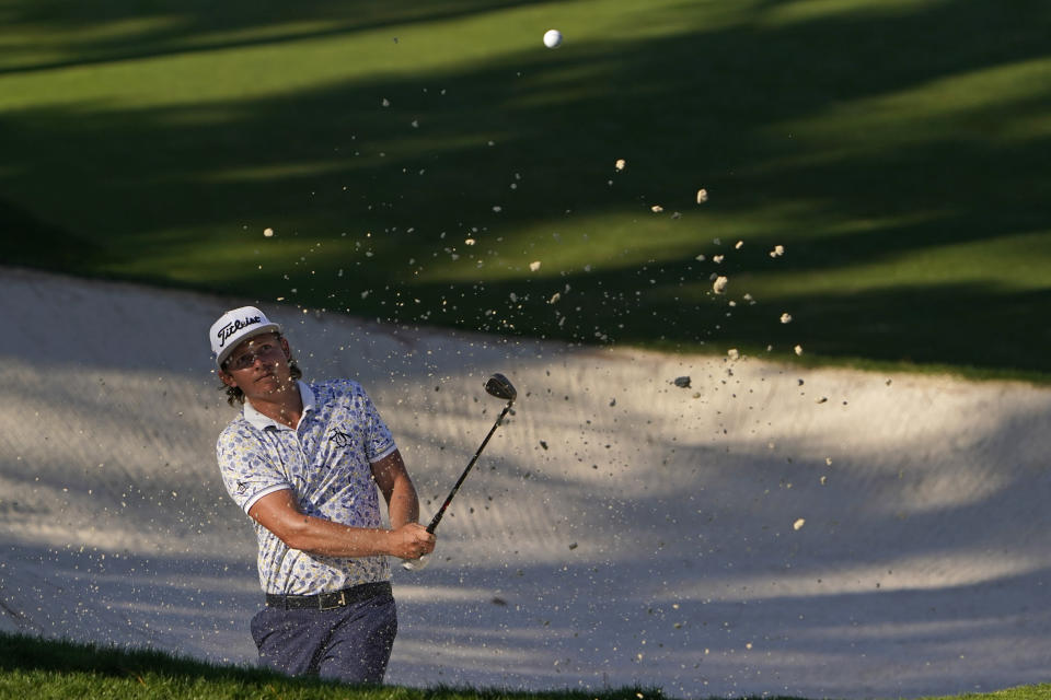 Cameron Smith, of Australia, hits out of a bunker not the 10th hole during the third round of the Masters golf tournament Saturday, Nov. 14, 2020, in Augusta, Ga. (AP Photo/Chris Carlson)