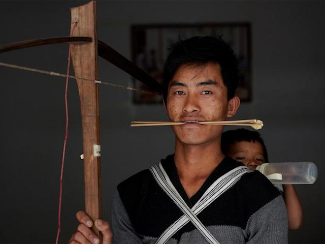 Chinese tribe aims to save its banned crossbow culture by turning it into an Olympic sport