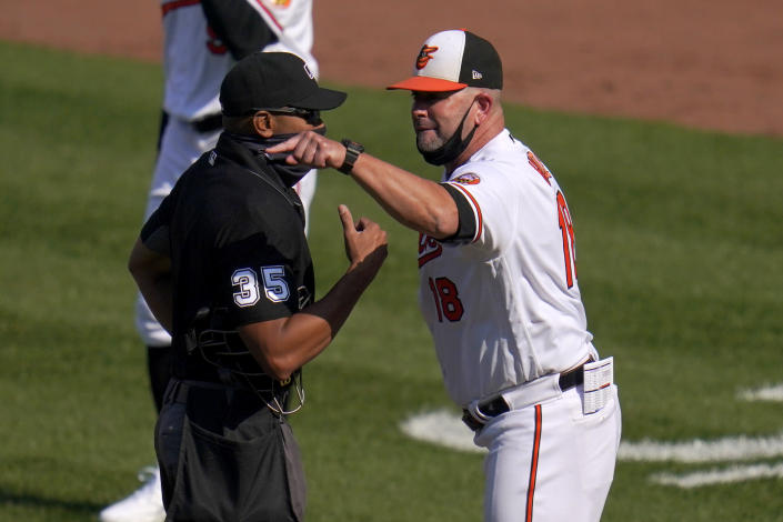 Baltimore Orioles manager Brandon Hyde, right, argues with home plate umpire Jeremie Rehak after the umpire ejected Hyde during the fourth inning of a baseball game, Thursday, April 8, 2021, on Opening Day in Baltimore. Hyde argued against a call on a pitch from Red Sox's Eduardo Rodriguez that hit Orioles' Rio Ruiz but wasn't awarded first base on a check swing strike. (AP Photo/Julio Cortez)