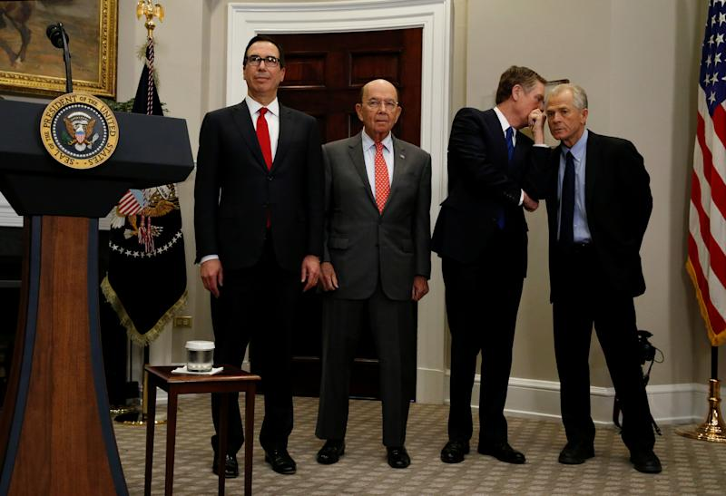 From left, Treasury Secretary Steven Mnuchin, Commerce Secretary Wilbur Ross, Robert Lighthizer, United States Trade Representative, and Peter Navarro wait for U.S. President Donald Trump to arrive to make an announcement about new tariffs for steel and aluminum imports at the White House in Washington, U.S. March 8, 2018. REUTERS/Leah Millis