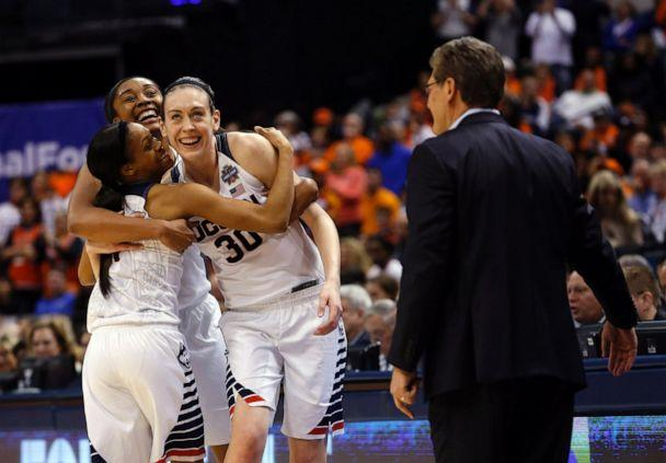 PHOTO: Connecticut's Morgan Tuck, left rear, Moriah Jefferson, left and Breanna Stewart, right, hug as Connecticut head coach Geno Auriemma watches following the championship game in the Final Four on Tuesday, April 5, 2016, in Indianapolis. (AJ Mast/AP, File)