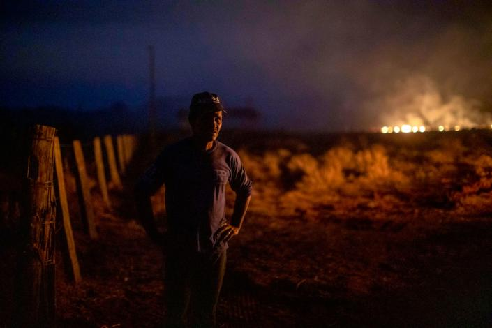 Brazilian Neri dos Santos, 48, looks at a fire at the farm where he works in Nova Santa Helena municipality, Mato Grosso state, in the Amazon basin, Brazil, on Aug. 23, 2019. (Photo: Joao Laet/AFP/Getty Images)