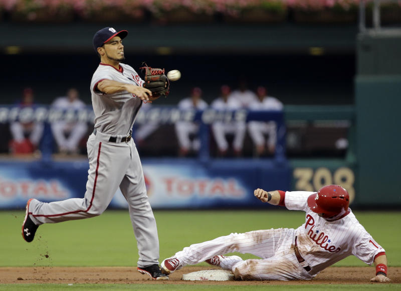 Washington Nationals second baseman Anthony Rendon throws to first after forcing out Philadelphia Phillies' Michael Young at second on a double play hit into by Delmon Young in the second inning of a baseball game, Tuesday, July 9, 2013, in Philadelphia. (AP Photo/Matt Slocum)