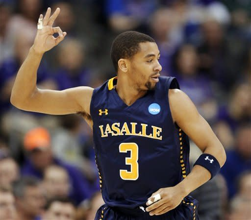 La Salle guard Tyreek Duren (3) celebrates a 3-point basket during the first half of a second-round game against Kansas State in the NCAA college basketball tournament at the Sprint Center in Kansas City, Mo., Friday, March 22, 2013. (AP Photo/Orlin Wagner)