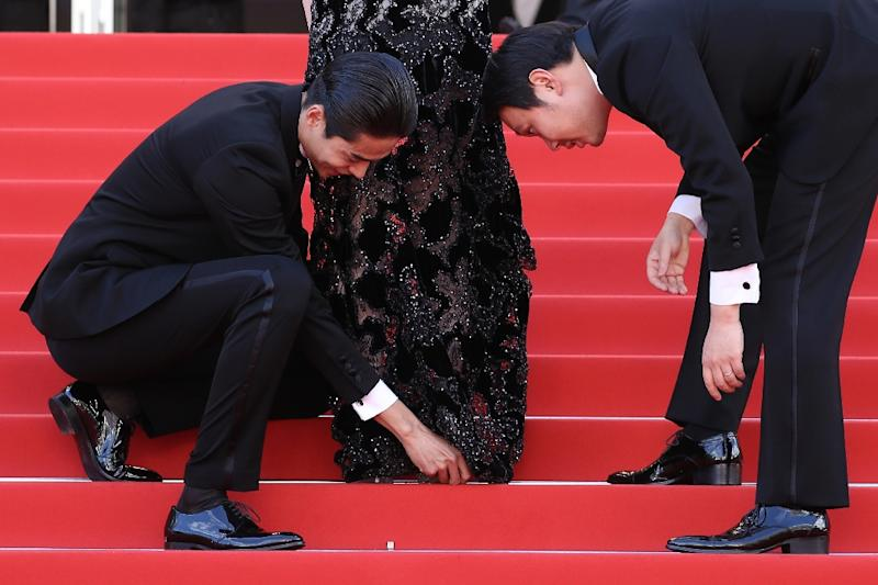 Japanese actress Erika Karata had to be rescued twice by her co-stars when she got her heel stuck in her dress (AFP Photo/Valery HACHE)