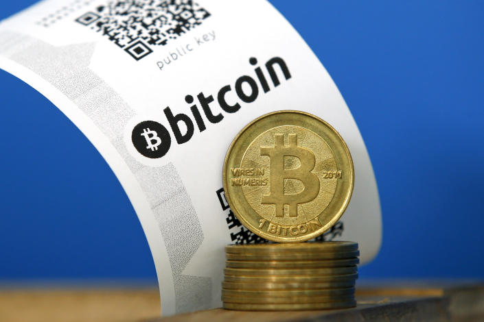 A Bitcoin (virtual currency) paper wallet with QR codes and coins are seen in an illustration picture taken at La Maison du Bitcoin in Paris July 11, 2014. French police dismantled an illegal Bitcoin exchange and seized 388 virtual currency units worth some 200,000 euros ($272,800) in the first such operation in Europe a public prosecutor said on Monday.   REUTERS/Benoit Tessier (FRANCE - Tags: BUSINESS)