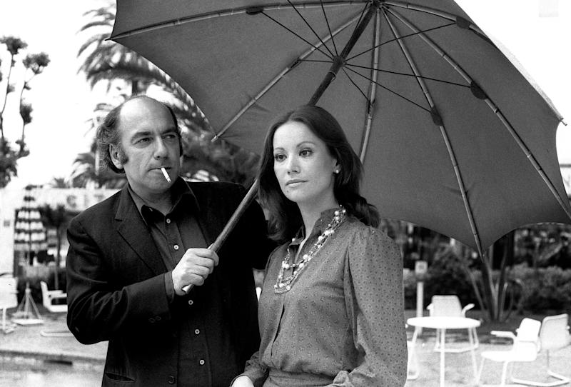 Claudine Auger with an umbrella