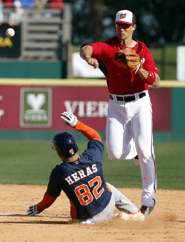 Houston Astros' Leo Heras (82) is out a second as Washington Nationals shortstop Zach Walters throws to first base to complete the double play in the ninth inning of a spring exhibition baseball game on Friday, March 7, 2014, in Viera, Fla. The Nationals won 8-5. (AP Photo/Alex Brandon)