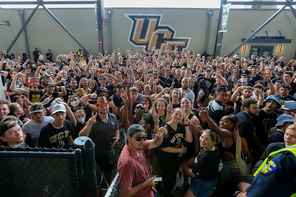 ORLANDO, FL - SEPTEMBER 02:  Students and fans wait after lightning delays the start of the Boise State versus UCF football game at the Bounce House on September 2, 2021 in Orlando, Florida. (Photo by Alex Menendez/Getty Images)