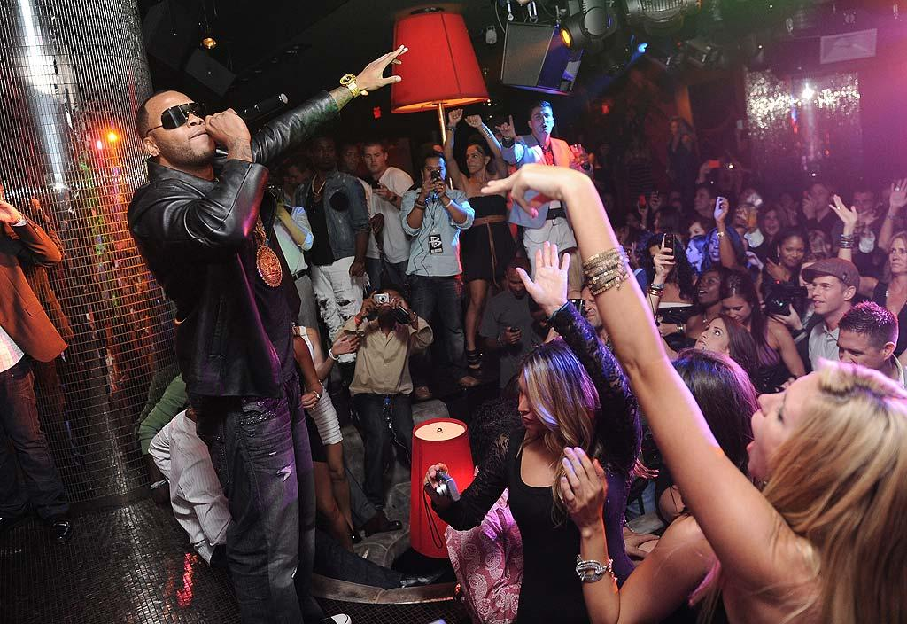 """Inside, rapper Flo Rida kept partygoers moving """"Right Round"""" throughout the evening. Check out the bling on his chest! Jordan Strauss/<a href=""""http://www.wireimage.com"""" target=""""new"""">WireImage.com</a> - August 3, 2010"""