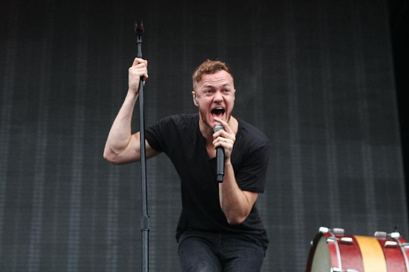 FILE - This Sept. 21, 2013 file photo shows Dan Reynolds of Imagine Dragons performing as part of Music Midtown 2013 at Piedmont Park in Atlanta. Imagine Dragons are part of a breed of newer and lesser known acts who are able to sell out top venues, even if they aren't selling millions of albums and singles, or dominating with chart-topping tracks and radio airplay. (Photo by Robb D. Cohen/Invision/AP, File)