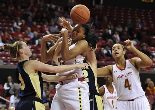Maryland's Alyssa DeVaughn, center, is unable to grab the rebound as Mount St. Mary's Melanie Mocniak, left, and Maryland's Malina Howard look on during the second half of an NCAA college basketball game Friday, Nov. 9, 2012 in College Park, Md. Maryland won 88-47.(AP Photo/Gail Burton)