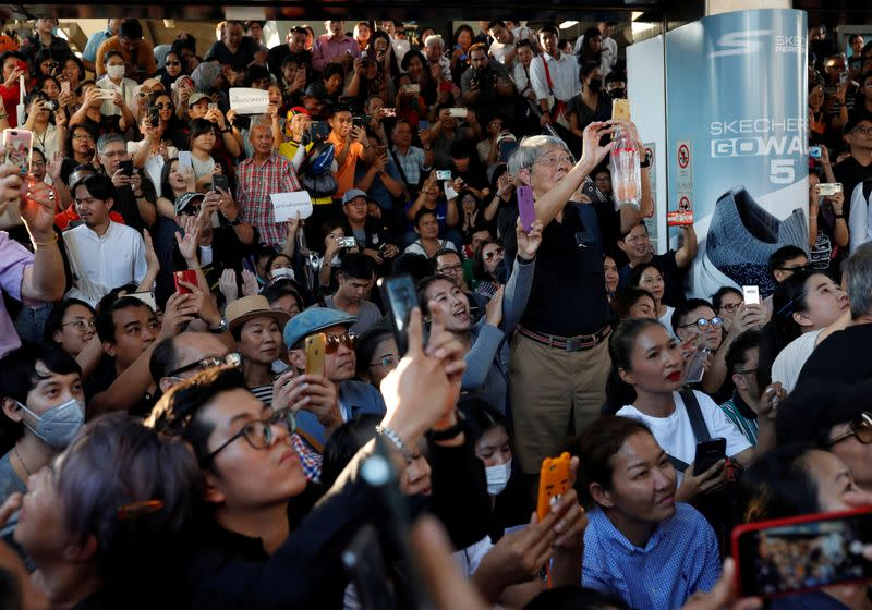 Supporters record with their phones at a sudden unauthorised rally by the progressive Future Forward Party in Bangkok