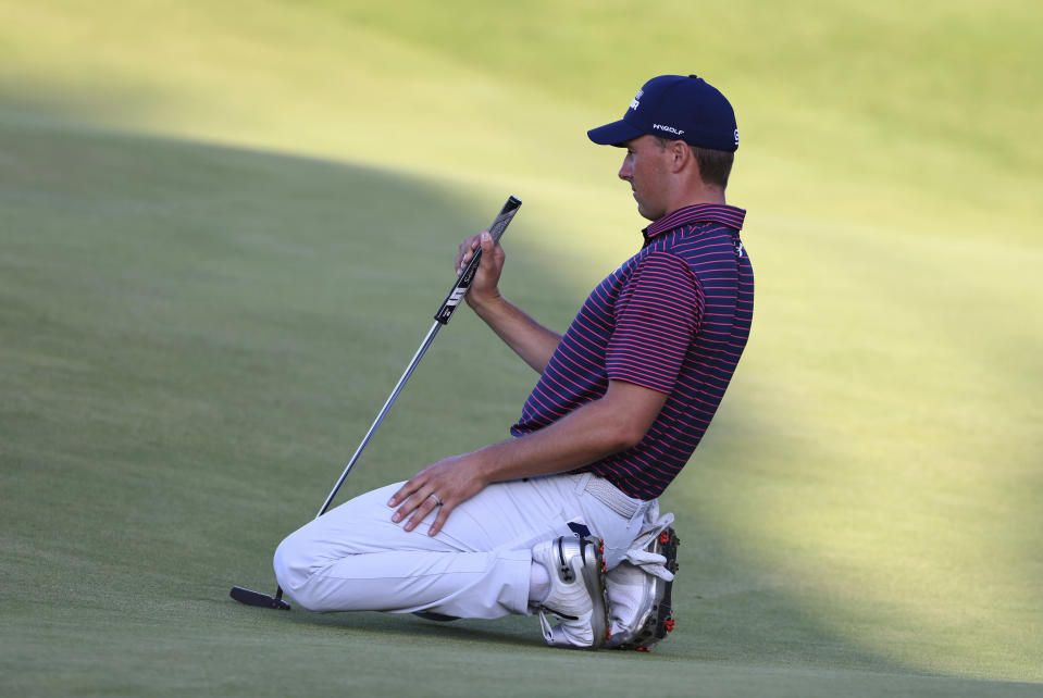 United States' Jordan Spieth looks at the line of his putt on the 18th green during the third round of the British Open Golf Championship at Royal St George's golf course Sandwich, England, Saturday, July 17, 2021. (AP Photo/Ian Walton)