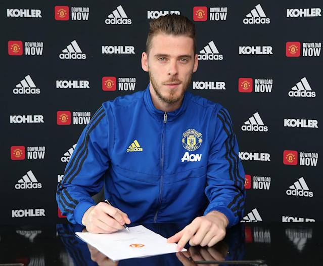 David de Gea of Manchester United poses after signing a new contract with the club. (Photo by John Peters/Manchester United via Getty Images)