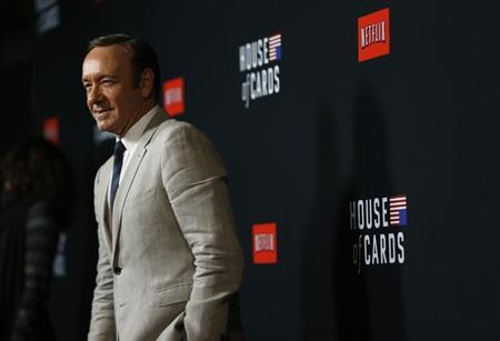 """Cast member Spacey poses at the premiere for the second season of the television series """"House of Cards"""" at the Directors Guild of America in Los Angeles"""
