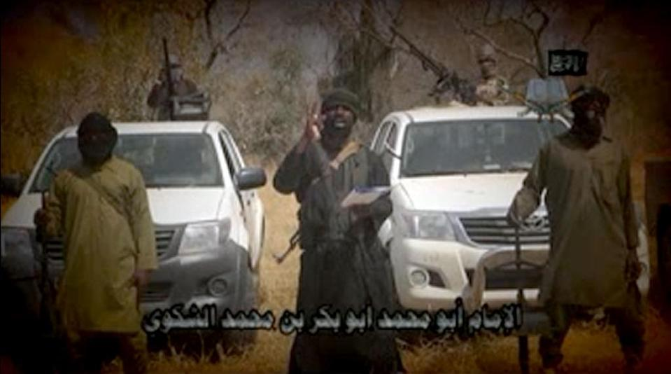 In this screen grab taken on February 9, 2015 from a video made available by Boko Haram, leader Abubakar Shekau (C) makes a statement at an undisclosed location (AFP Photo/)
