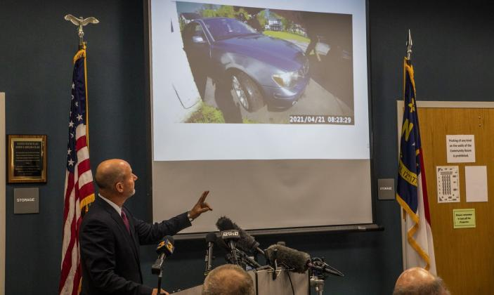 Pasquotank County District Attorney Andrew Womble shows still images from police body camera footage after announcing he will not charge deputies in the April 21 fatal shooting of Andrew Brown Jr. during a news conference Tuesday, May 18, 2021 at the Pasquotank County Public Safety building in Elizabeth City, N.C. Many police departments — including in large U.S. cities such as New York and Chicago — ban or strictly limit shooting into moving vehicles after concluding that the practice is ineffective and not worth the risk to human life. But it is still happening and defended as a justifiable use of force in other areas, including the small municipality of Elizabeth City(Travis Long/The News & Observer via AP)