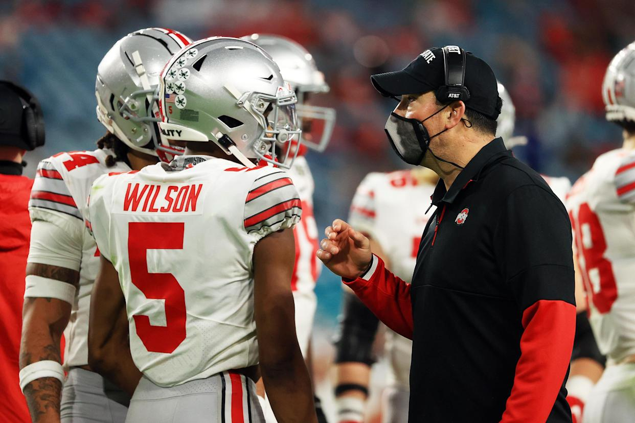 MIAMI GARDENS, FLORIDA - JANUARY 11: Head coach Ryan Day of the Ohio State Buckeyes talks with Garrett Wilson #5 against the Alabama Crimson Tide during the second quarter of the College Football Playoff National Championship game at Hard Rock Stadium on January 11, 2021 in Miami Gardens, Florida. (Photo by Mike Ehrmann/Getty Images)