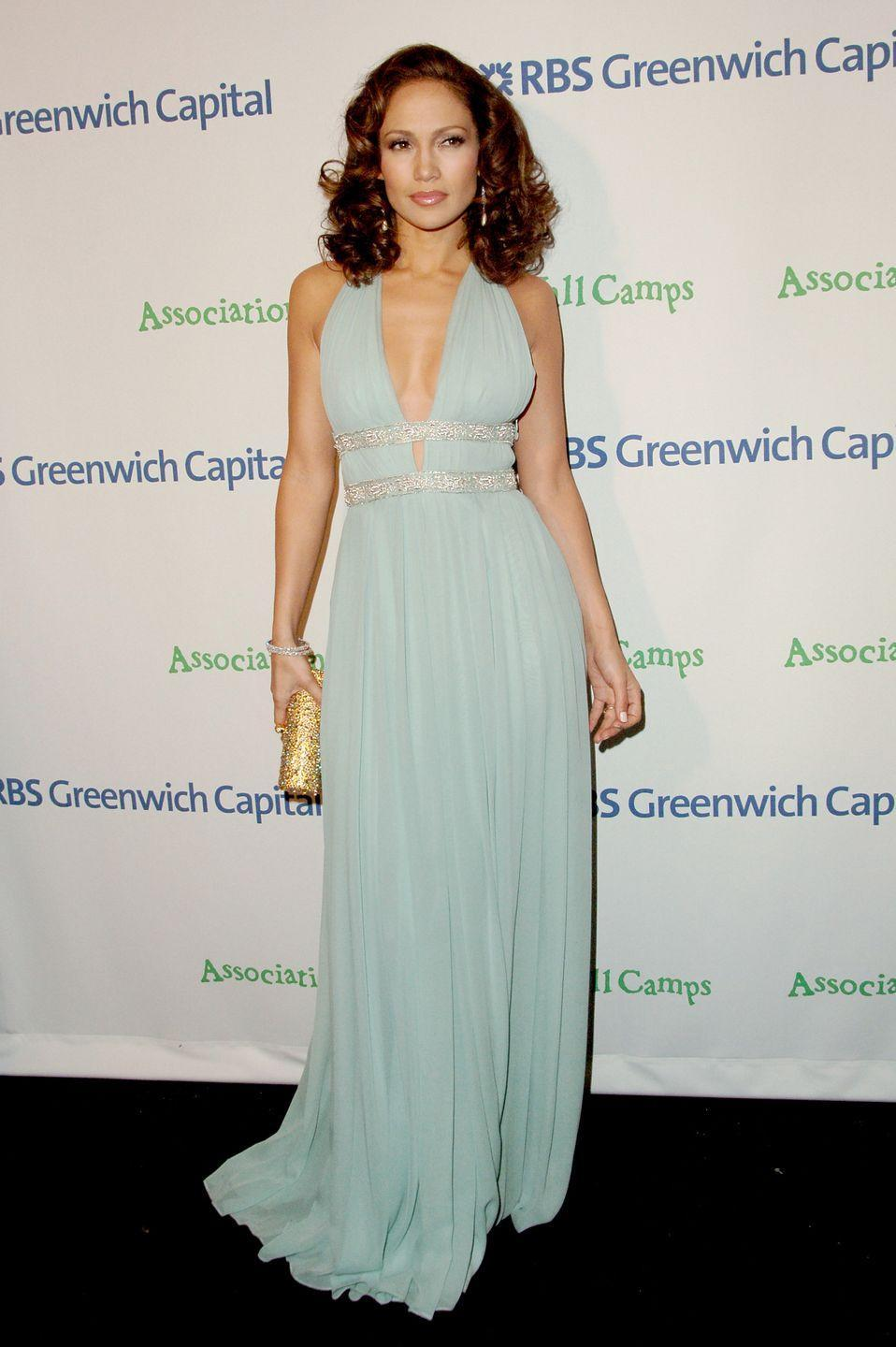 <p>Here, she gives us regal vibes in this plunging halter gown featuring a bejeweled belt at Tony Bennett's 80th birthday celebration. Like, this aqua shade seriously looks so good on her. </p>