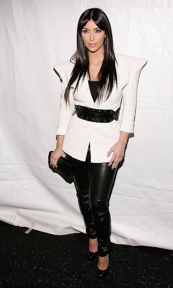"""Reality TV """"star"""" Kim Kardashian wowed the crowd at the Y-3 Fall 2009 fashion show in a futuristic Maison Martin Margiela jacket, leather pants, wide belt, and Yves St. Laurent """"Trib Two"""" pumps. Joe Kohen/<a href=""""http://www.wireimage.com"""" target=""""new"""">WireImage.com</a> - February 15, 2009"""
