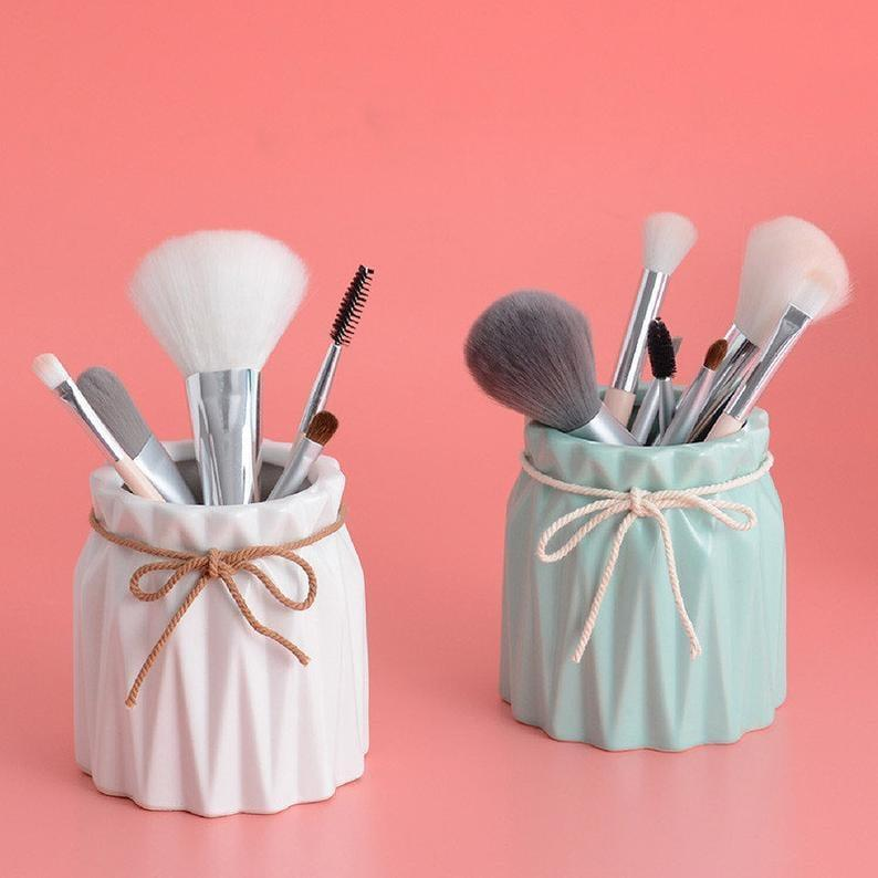 <p>Brighten up your vanity with these pastel-toned<span>Ceramic Makeup Brush Holders</span> ($27).</p>