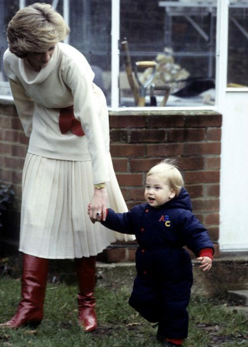 Princess Diana walks with a young William, bundled up in London in 1983.